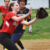 BRYAN EATON/Staff photo. A Lynnfield player makes it to third as baseman Ashley Porcaro waits for the throw on an error.