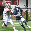 BRYAN EATON/Staff photo. Newburyport's Zach Hogan (#13) defends against an Exeter player.