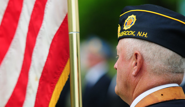 JIM VAIKNORAS/Staff photoRoland Cormier of American Legion Post 70 holds the colors during the Memorial day Service at Seabrook Square Sunday morning.