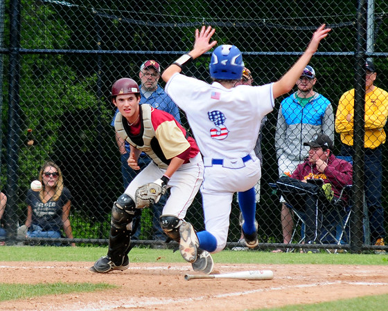 JIM VAIKNORAS/Staff photo  Georgetown's Jacob Aamsky slides into home as the ball gets away from Newburyport's Ken Hodge during the annual Bert Spofford tournament at Georgetown Sunday.