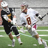 BRYAN EATON/Staff photo. Newburyport attacker Paul Federico looks for a way around a Bishop Fenwick defender.
