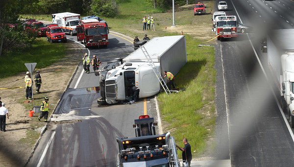 BRYAN EATON/Staff photo. A tractor-trailer carrying mulch rolled over on the Route 286 onramp to Interstate 95 in Salisbury late Wednesday afternoon. Southbound traffic was not affected, but people were unable to use the onramp and being diverted until the scene was cleared.