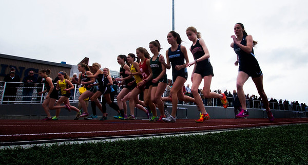 JIM VAIKNORAS/staff photo Runners take off at the start of the girls mile run at the Hernry Sheldon track meet at Triton Saturday.