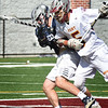 BRYAN EATON/Staff photo. Newburyport offensive player Owen Bradbury (#5) collides with an Exeter player.