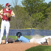 BRYAN EATON/Staff photo. Triton's Thomas Lapham steals second, as baseman Thomas Furlong waits for the throw.