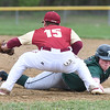 BRYAN EATON/Staff photo. Pentucket's Nathan McCarthy makes it back to first past Newburyport baseman Jaden Medeiros.