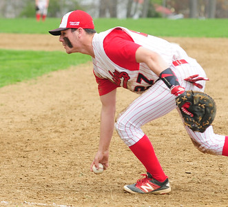 JIM VAIKNORAS/staff photo Amesbury's Zach Prentiss makes a play on a ground ball against Triton during their game at Amesbury Saturday morning.