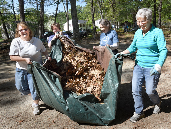 BRYAN EATON/Staff photo. At least 50 mostly First Religious Society Unitarian Universalist Church members cleaned up Woodman Park in Newburyport. This was an effort to show the congregation's appreciation for the city giving money to help renovate the church and steeple. Moving years of accumulated oak leaves are, from left, Leslie Lawrence, Patricia O'Brien, Annie Maurer and chair of the parish board Barbara Garnis.
