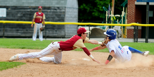 JIM VAIKNORAS/Staff photo Newburyport's Cam MacRea tags out Georgetown's Luke Hall as he slides into second during the annual Bert Spofford tournament at Georgetown Sunday.