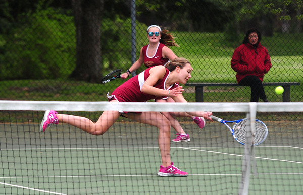 JIM VAIKNORAS/staff photo Newburyport first double player Sophie Page returns a shot, with partner  Emma Fillipancicbacking her up, during their match against Masconmet's Ellie Scheirey and Shayna Fizz at Atkinson Common Thursday.