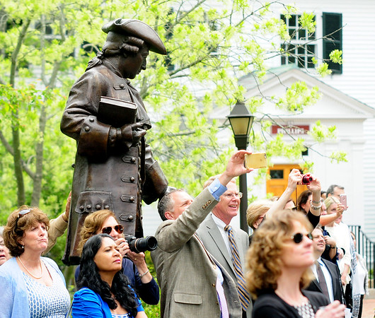 JIM VAIKNORAS/staff photo Family and friend take photos under the watch of the statue of school namesake William Dummer at the 254th Commemcement of the Governor's Academy.