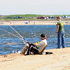 JIM VAIKNORAS/Staff photo Fsihermen along Plum Island Point in Newburyport hope to hook stripped bass as the tide comes in teh mouth of the Merrimack River Saturday.