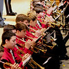 JIM VAIKNORAS/Staff photo The Amesbury Hgh School band performs the themes from the different armed services during the Amesbury Memorial Day ceremony at Amesbury High School Monday.Veteran were encouraged to stand during the song for their service branch. The event was moved inside due to the rain.