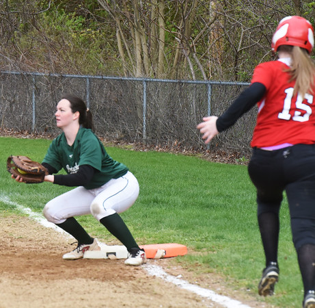 BRYAN EATON/Staff photo. Pentucket first baseman Olivia Sisson has the ball before Amesbury's Kaylie Cloutier makes the base.