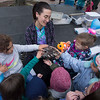 JIM VAIKNORAS/Staff photo Kids pet a tegu lizard being held by Alana Hess of Plastow,owner of Zoo Parties with Alana, at the Newburyport Spring Festival in Market Square Monday. Tegus are native to South America.