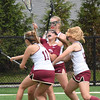 BRYAN EATON/Staff photo. Gloucester's Rachel Alexander finds herself surrounded by Newburyport defenders.