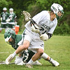 BRYAN EATON/Staff photo. Pentucket's Liam Sheehy comes away with the ball after colliding with Manchester-Essex's #15.
