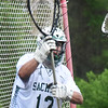 BRYAN EATON/Staff photo. Pentucket goalie Robert Porter stops a shot.