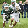 BRYAN EATON/Staff photo. Manchester-Essex player Robert Beardsley scoops up a loose ball as Pentucket's Nick Lamattina moves in.