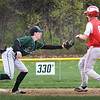 BRYAN EATON/Staff photo. Pentucket shortstop Jacob Deziel tags out Amesbury's Ray Arsenault.