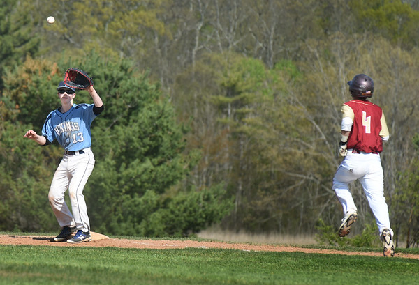 BRYAN EATON/Staff photo. Triton first baseman Tyler Godfrey gets the throw from pitcher Dylan Copeland forcing Newburyport's Thomas Furlong out.