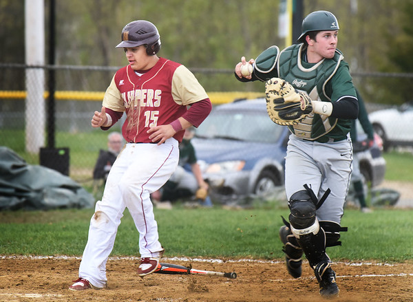 BRYAN EATON/Staff photo. Pentucket catcher Steve Noyes forces out Newburyport's Jaden Medeiros and looks to make it a double.