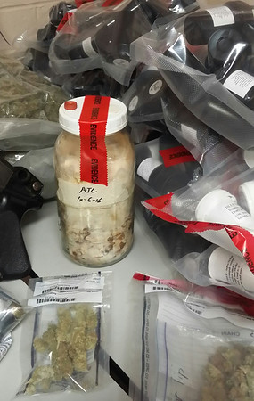 ANGELJEAN CHIARAMIDA/Staff photo. Among the substances police confiscated Tuesday was a large jar of what is suspected to be hallucinogenic mushroom, along with LSC and a white power yet to be identified.