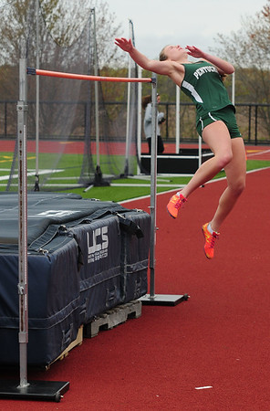 JIM VAIKNORAS/staff photo Pentucket's Katie Giusti in the high jump at the Hernry Sheldon track meet at Triton Saturday. Giusti teed for first with her teammate Siobhan Mitchell.