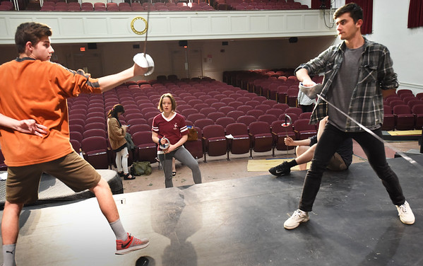 BRYAN EATON/Staff photo. Boston stage combat choreographer Angie Jepson, center, is helping Newburyport High School theater students in their upcoming play Hamlet with their fencing. Here she works with Sean Denner, left, as Laertes and Hunter Torr as Hamlet.
