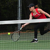 JIM VAIKNORAS/staff photo Masconomet's third singles player Caroline May returns a shot from Newburyport's Adria Samualson  during their match at Atkinson Common Thursday.