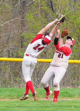 JIM VAIKNORAS/staff photo Amesbury's #14 Logan Burrill and #21 Derek Beaupre make a play on a fly ball against Triton during their game at Amesbury Saturday morning.