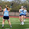 BRYAN EATON/Staff photo. Triton's Samantha Brown throws to teammate Erin Savage.