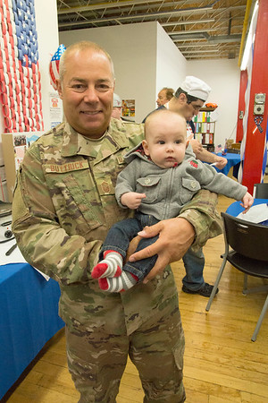 "JIM VAIKNORAS/staff photo 	Air Force SMSgt Todd Buttrick holds his gradson Mason Corrigan at the Coastal Connections in Amesbury's "" A Brunch for Vets ""  Friday morning."