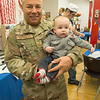 """JIM VAIKNORAS/staff photo Air Force SMSgt Todd Buttrick holds his gradson Mason Corrigan at the Coastal Connections in Amesbury's """" A Brunch for Vets """"  Friday morning."""