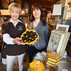 BRYAN EATON/Staff photo. Annual Newburyport Chocolate Tour co-chairman Diane Hawkins-Clark, left, with Wishbasket owner Kerry Vaughan who is one of the participant businesses.