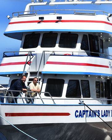 BRYAN EATON/Staff photo. Brothers Chris Charos, left, and Ryan are getting their whale watching ship Captain's Lady III for the season.