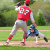 JIM VAIKNORAS/staff photo Amesbury's Zach Prentiss waits for the throw as Triton's Thomas Lapham dives back to first during their game at Triton Sunday.