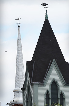 BRYAN EATON/Staff photo. The weather vanes of the Central Congregational Church, left, and Mission Oak Grille are in sync pointing to the east, north, east where Tuesday's wind came from, making the weather feel cooler. The rest of the week will be a little below normal for this time of year.