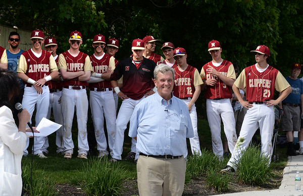 BRYAN EATON/Staff photo. Mayor Donna Holaday introduces Richie Eaton, flanked by the Newburyport High School baseball team, at the dedication of the baseball field named after him.