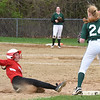 BRYAN EATON/Staff photo. Amesbury's Emma DePietro steals third base.