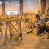 RYAN HUTTON/ Staff photo<br /> Doug lamb work on a paddle next to the frame work of the wooden kayak he is building at a kayak building workshop hosted at CI Works in Amesbury.