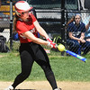 BRYAN EATON/Staff photo. Hayley Catania swings but hits the ball out of bounds.