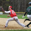 BRYAN EATON/Staff photo. Amesbury first baseman Zachary Prentiss makes the throw as Pentucket's Conor O'Neil runs over the base.