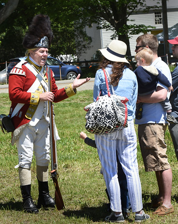 BRYAN EATON/Staff photo. Eric Niehaus as His Majesty's 10th Regiment of foot talks to visitors.