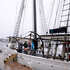 JIM VAIKNORAS/staff photo Crew members and visiots don rain gear as ther tour the Alabama, one of 2 tall ships docked on Newburyport's waterfront. The ships will be visiting till Monday .