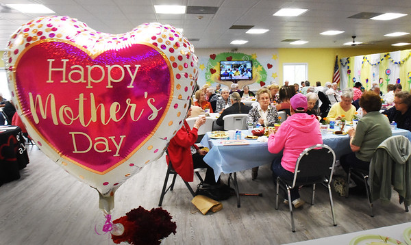BRYAN EATON/Staff photo. The Salisbury Council on Aging hosted at Mother's Day Brunch at the Hilton Center on Monday morning. Students at the Salisbury Elementary School's Kid's Inc. Club made decorations for the event.
