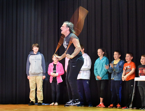 "BRYAN EATON/Staff photo. Mark Rothstein brought his ""World of Jump Roping"" to the Pine Grove School in Rowley, here doing 31 rapid jumps to the applause of students he brought on stage. Some of the students also got into the act learning different jumping techniques."