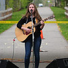 JIM VAIKNORAS/staff photo Thomasina Glenn of Amesbury performs at the Salisbury Art Stroll on the Rail Trail Saturday morning.
