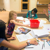 JIM VAIKNORAS/Staff photo Sophia Kelly, 10, Kaya Field, 7, Anya Ibrahim,8, and Alexa Warchol,9, play games and draw at a community iftar at the Senior center in Newburyport Wednesday night.
