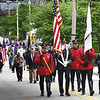 BRYAN EATON/Staff photo. Amesbury Fire and Police Department Color Guard lead the Memorial Day parade down Main Street to Landry Memorial Stadium.